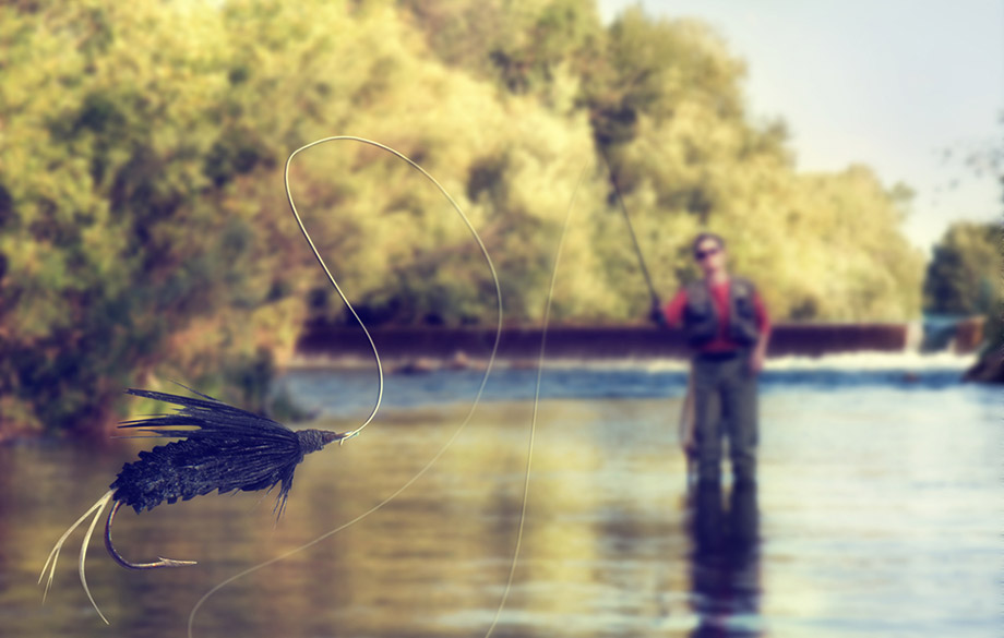 man casting a fly fishing line