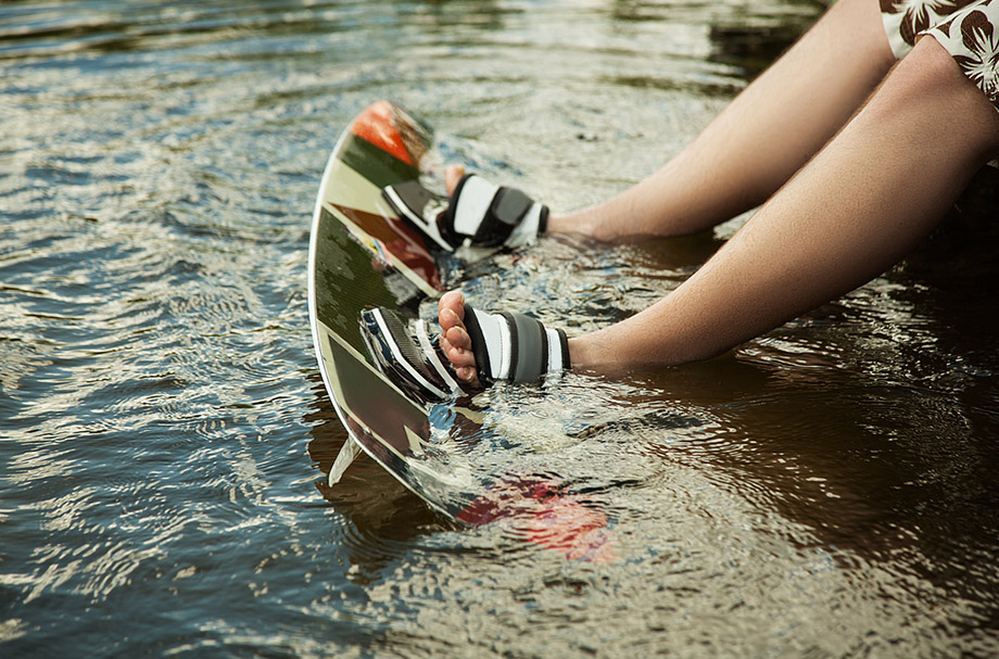 wakeboard and feet in the water