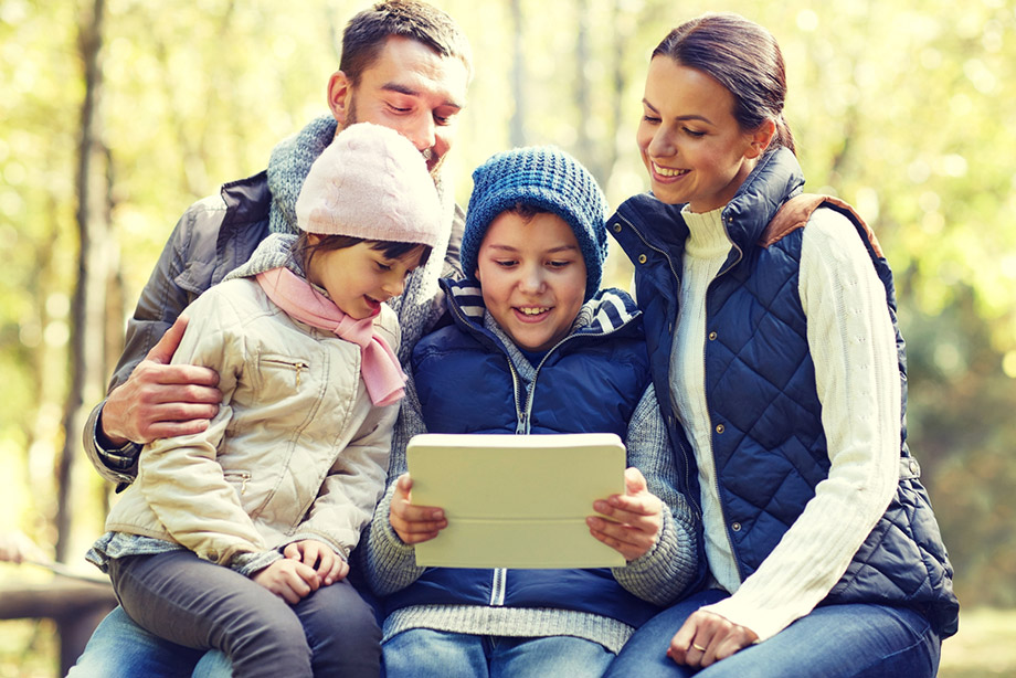 family looking at camping apps