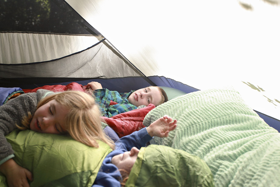kids sleeping in a tent