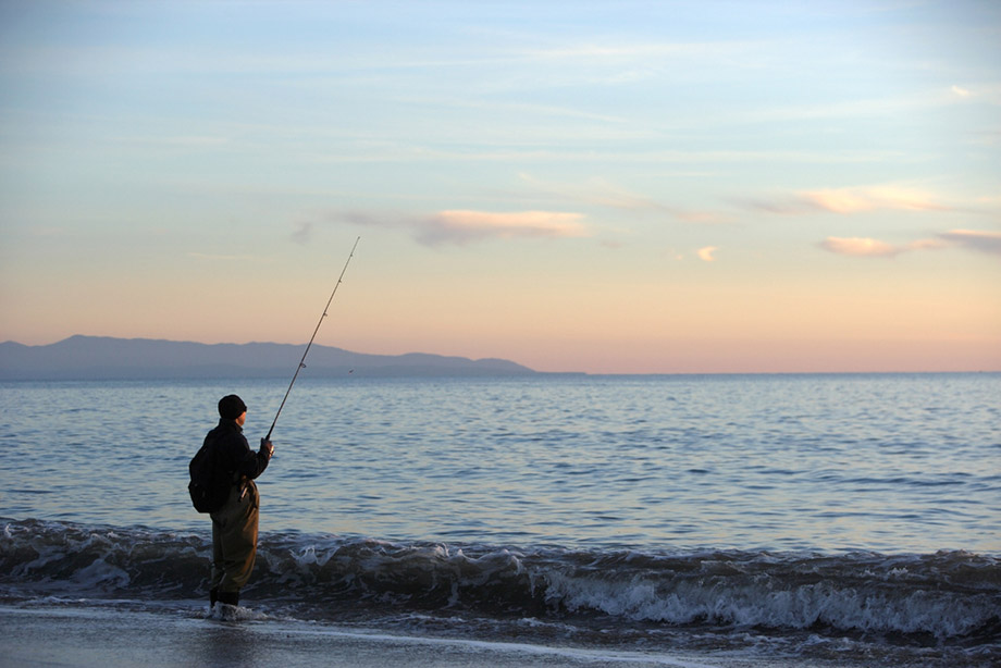 Man Beach Fishing