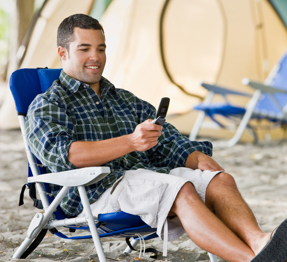 man phone campsite