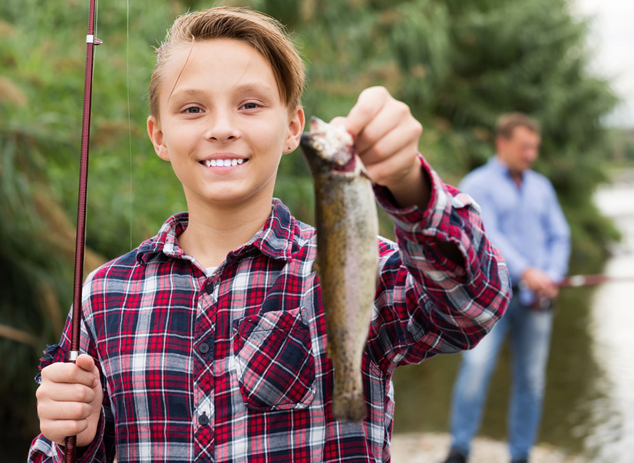Boy Catches Fish