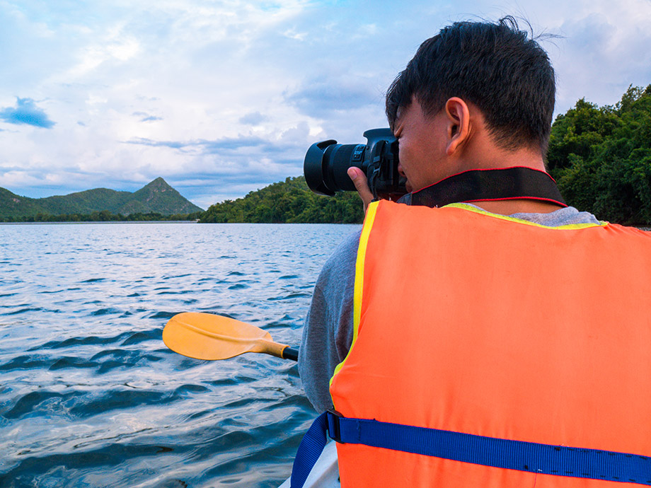 Man Takes Photo From Kayak