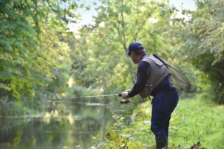 Man Fishing River