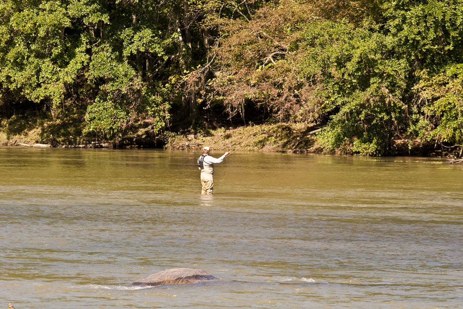 Man Fly Fishing After Flooding