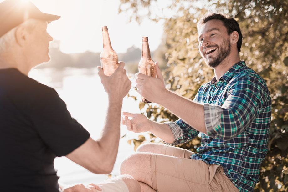 Two Men Laughing By River