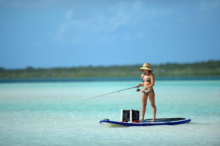 Woman Standing Surfboard Fishing
