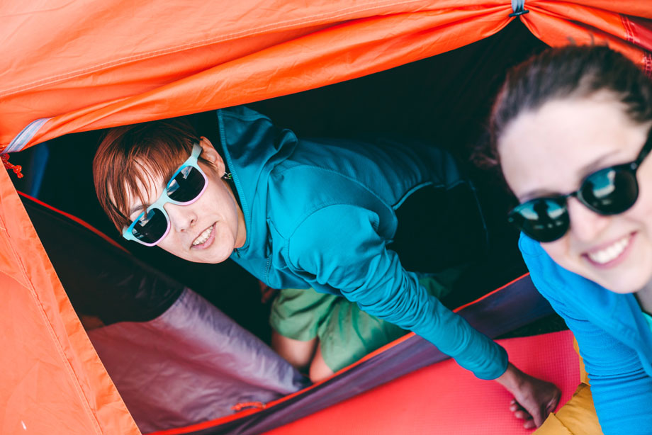 Two Women Smiling In Tent
