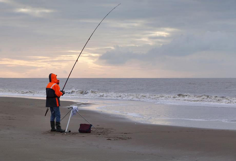 Man Beach Fishing Winter