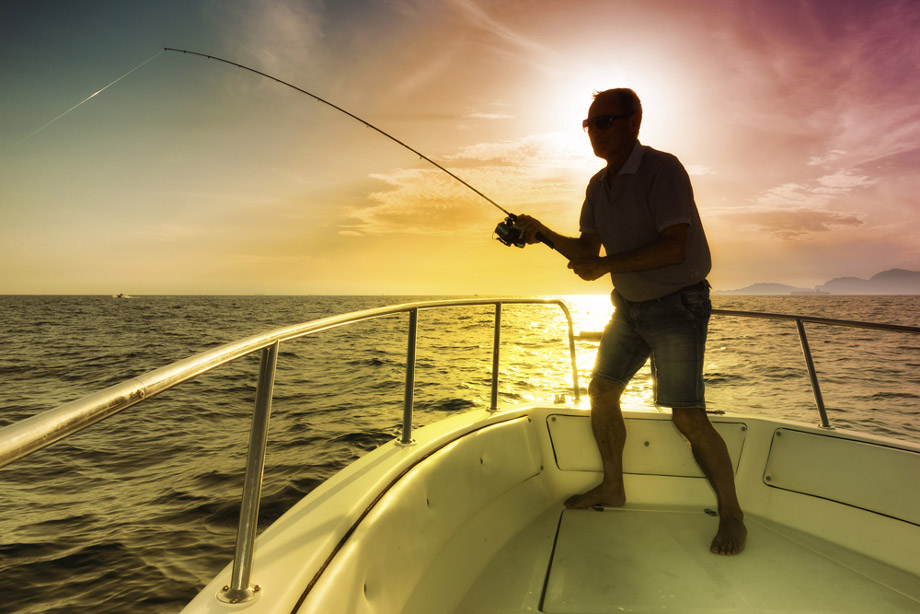 Man Fishing On Boat Charter