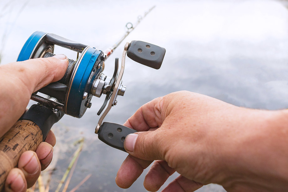 Baitcasting Reel In Hands Of Angler