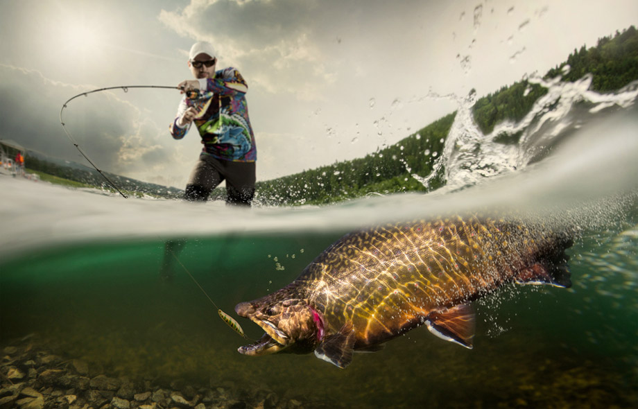 Man Fishing With A Lure Spectacular Half Underwater View