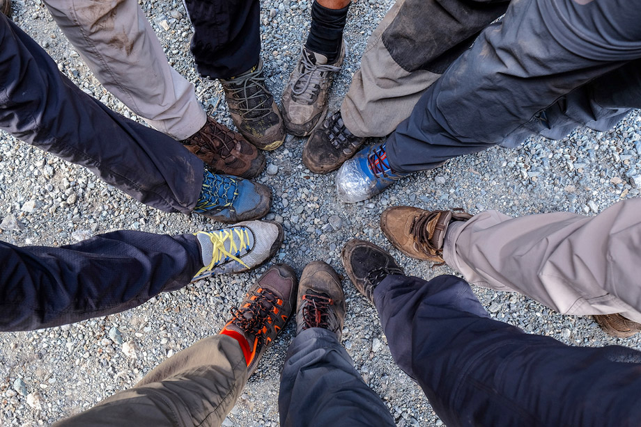People In A Circle Showing Their Hiking Shoes