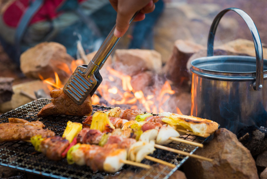 Cooking Food Over Campfire