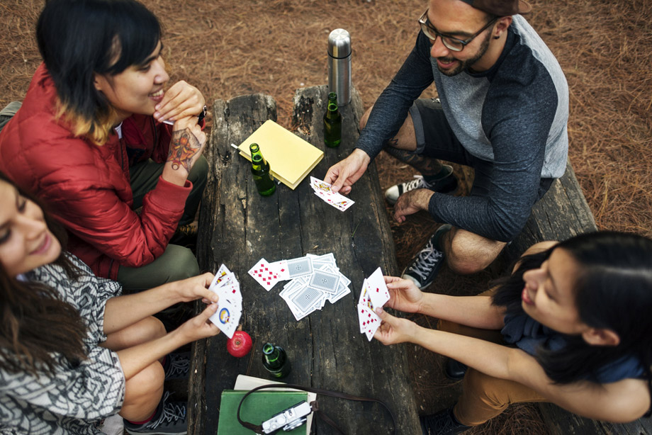 Group Playing Cards While Camping