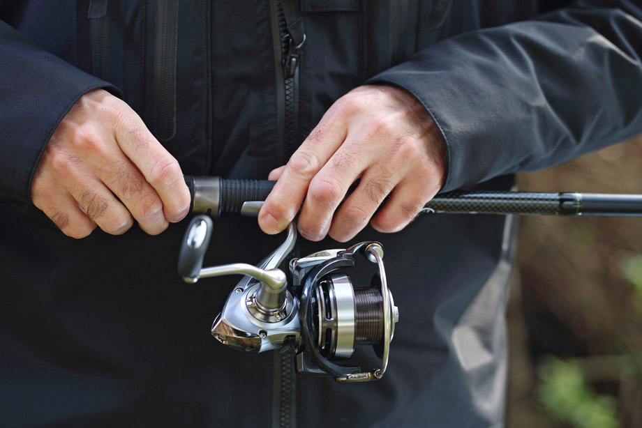 Man Holds Fishing Rod And Reel