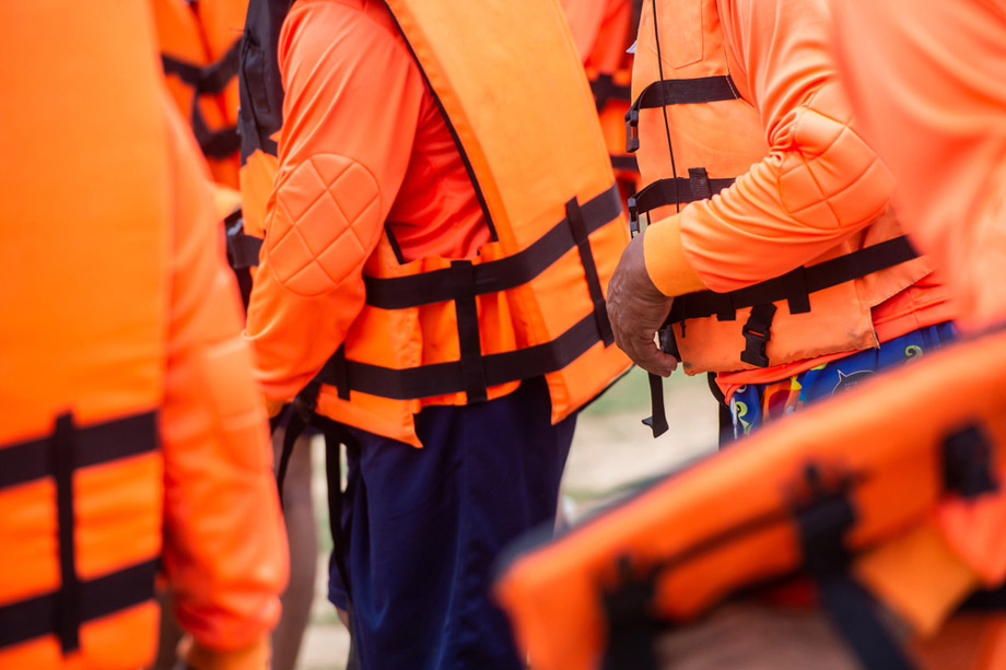 Three Men Wearing Life Jackets