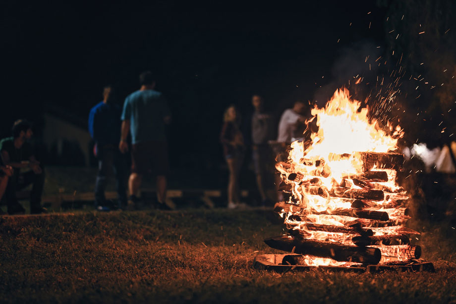 Adults Around A Campfire