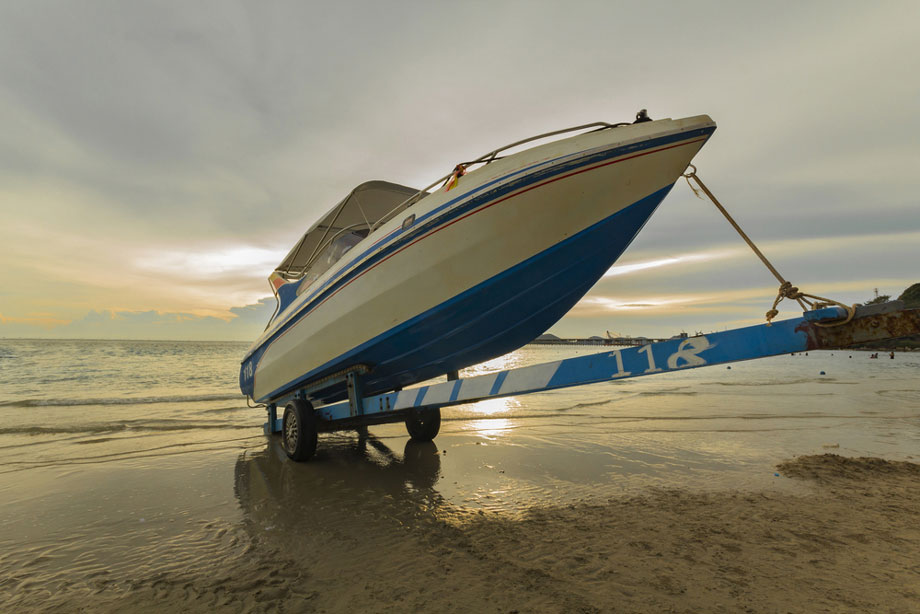 Boat On Trailer On The Beach