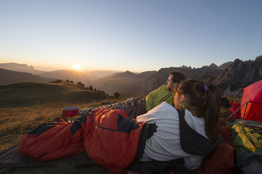 Couple Watching Sunset While Camping