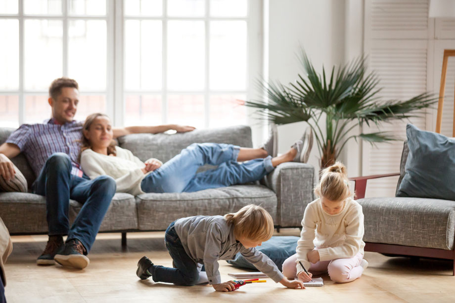 Family Rests In Lounge Room