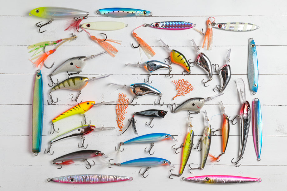 Variety Of Lures On White Wooden Background