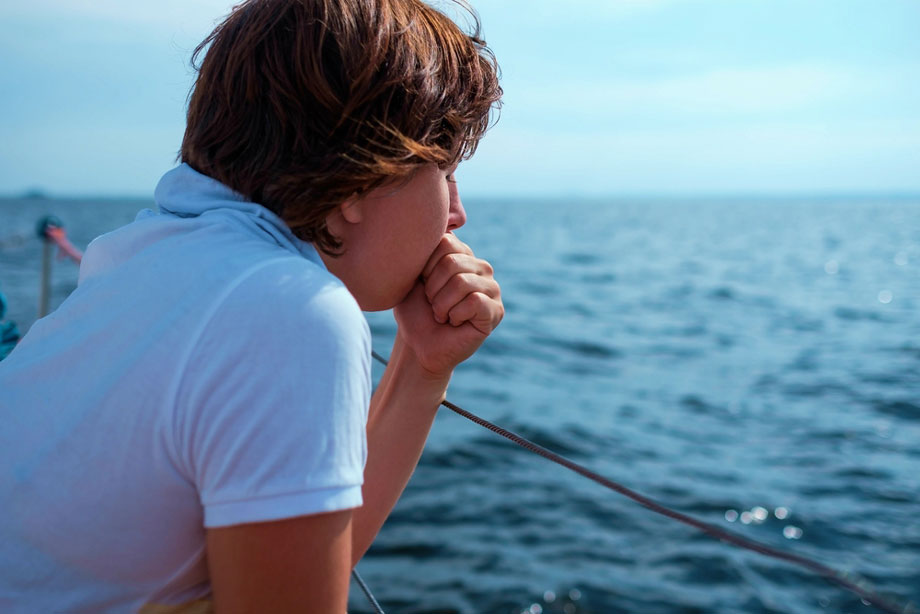 Woman Feeling Sea Sick On Boat