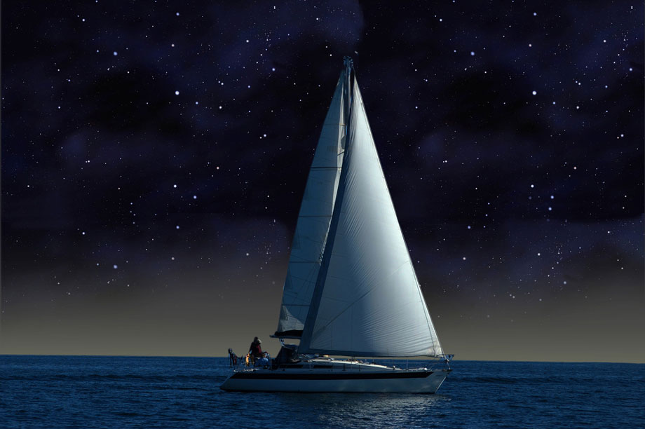 Yacht At Night On Ocean