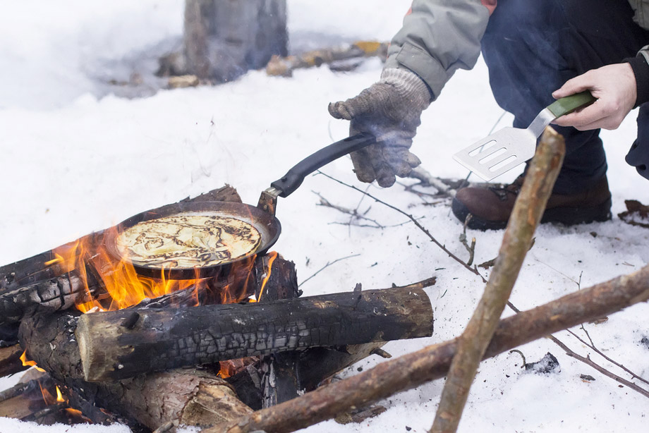 Cooking On Campfire In Winter Snow