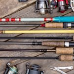 Fishing Rods On Wooden Deck