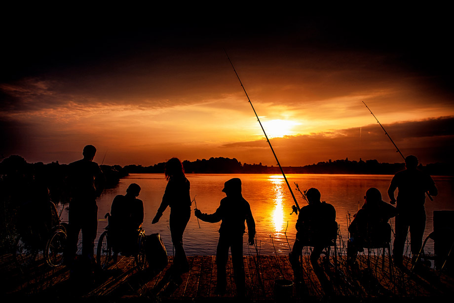 Group Of People Fishing At Night