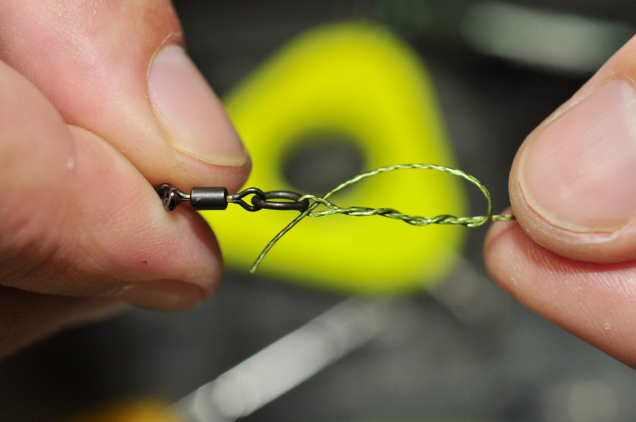 Hands Holding Fishing Line And A Knot