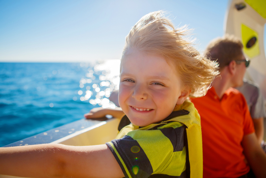 Happy Child On Boat