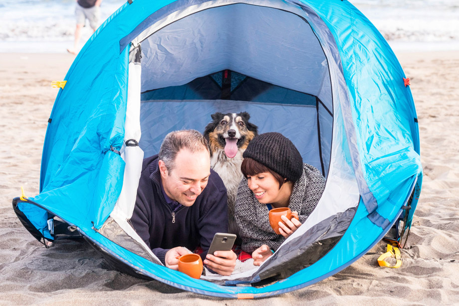 Man And Woman In Tent With Dog