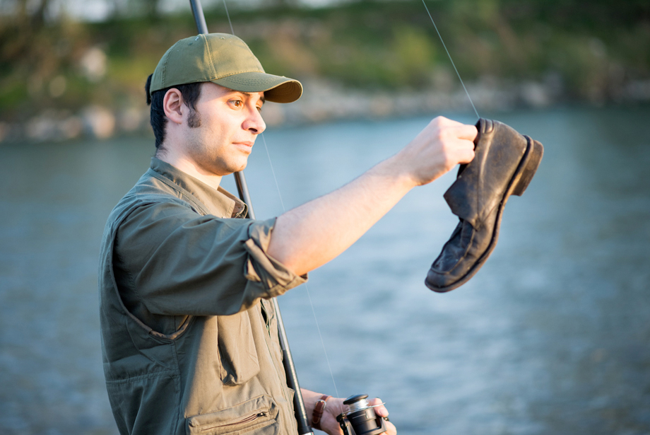 Man Catches Boot With Fishing Gear