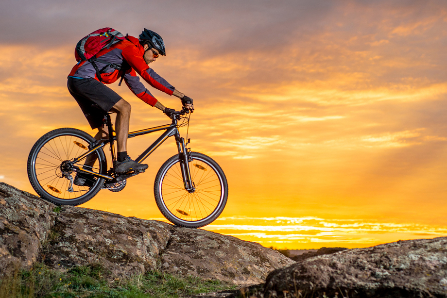 Man On Mountain Bike On Top Of Ridge