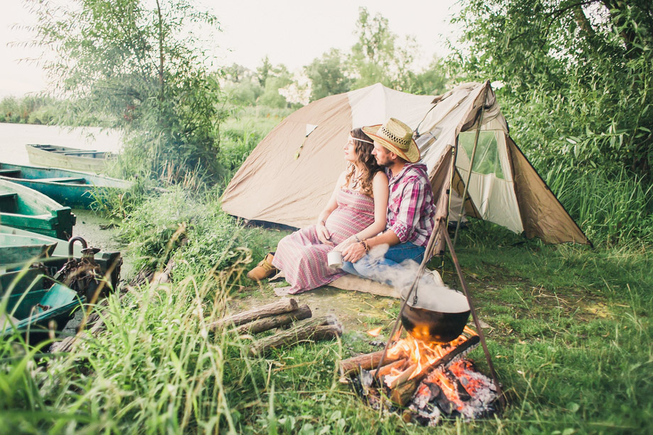 Pregrant Woman With Man Camping