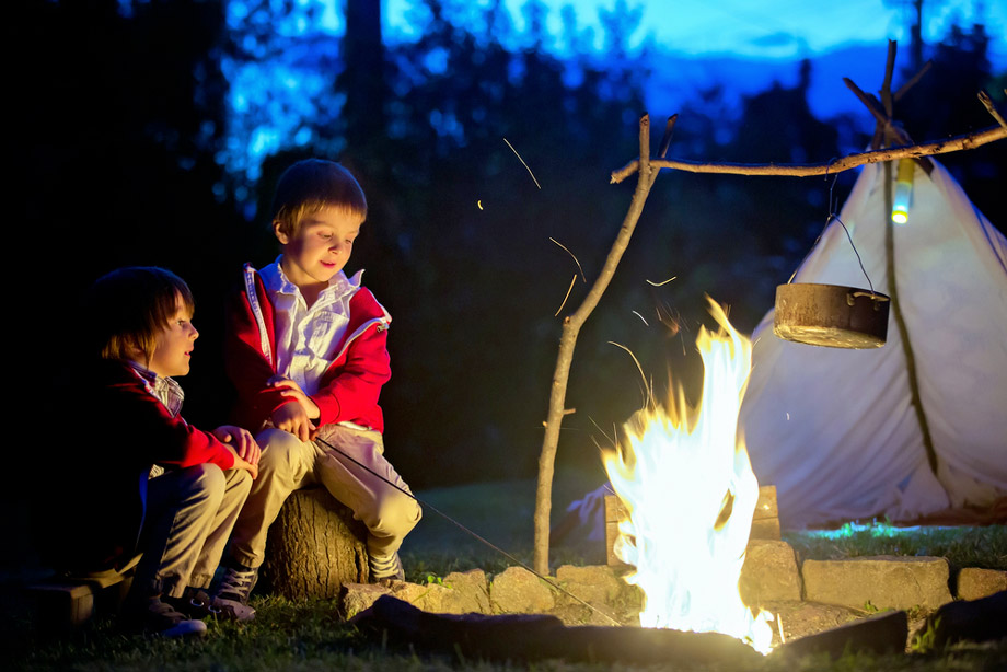 Two Boys By A Campfire